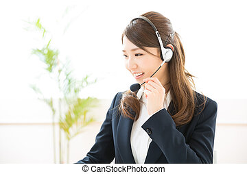 Operator - young attractive asian woman who works as an ...