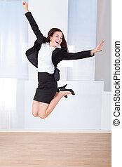 opgewekte, businesswoman, springt