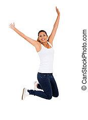 opgewekte, jonge vrouw , springt