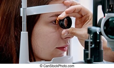 ophthalmologist - the ophthalmologist is looking at the ...