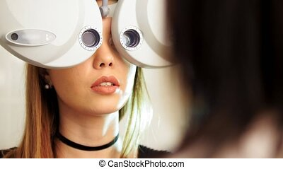 Ophthalmology clinic - woman checks vision by modern...