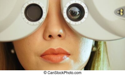 Ophthalmology clinic - woman checks vision eyesight, close...
