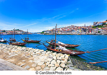 Oporto or Porto city skyline, Douro river and traditional boats. Portugal, Europe.