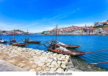 Oporto or Porto city skyline, Douro river and traditional boats. Portugal, Europe.