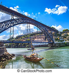 Oporto or Porto skyline, Douro river, boats and iron bridge....