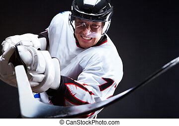 Opponent - Angry ice-hockey player pointing stick into ...