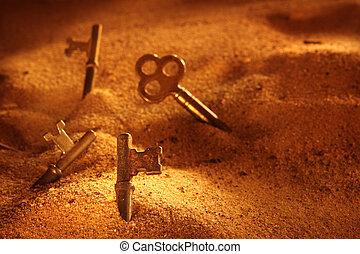 a dramatically lit scene of skeleton keys in piles of sand