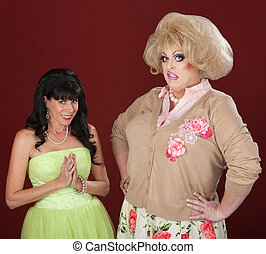 Innocent woman and disgusted drag queen over red background