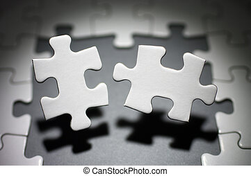 Opposite two jigsaw puzzle pieces.