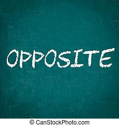 OPPOSITE written on chalkboard