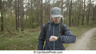 Oprientation with Compass - Young traveler man with backpack...