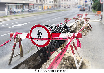 Optic and electric cable - Road excavation at a construction...