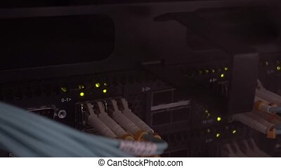 Optical port in a blade server in data center. Optical Fiber Cable Connector Activity Indicator Blinking in a Hub.