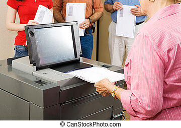 Optical Scanner Voting - Closeup of a woman feeding her...
