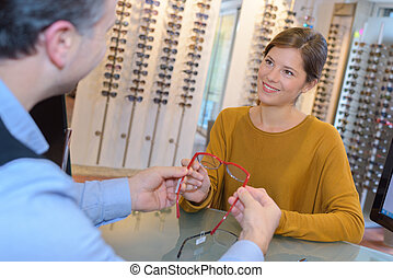 Optician advising customer