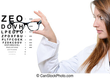 Woman with glasses and snellen eye chart in background