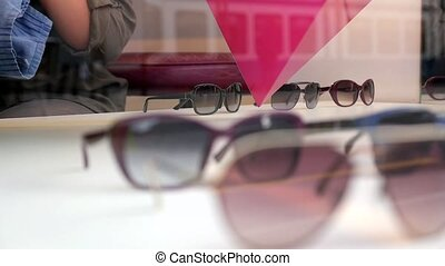 Optician in Zurich - HD 1080p - Shopassistant is cleaning...