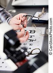 optician repairing glasses