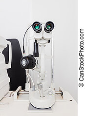 Optician's machine for eye examination.