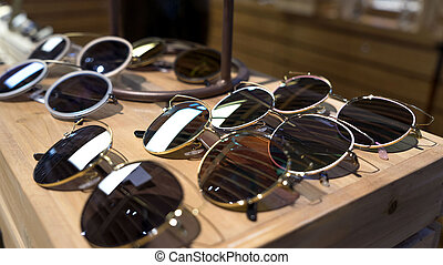 Opticians with glasses, Sunglasses that are on display.