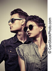 optics style - Fashion shot of an attractive young couple in...