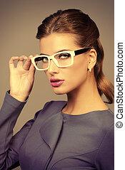 elegant glasses - Optics style. Portrait of a beautiful...