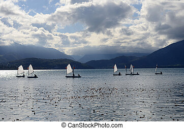 Optimist os sailing dinghy on Annecy lake