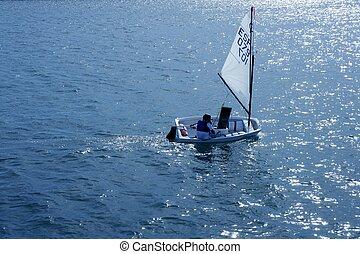 Optimist, recreation little sailboat regatta, Spain