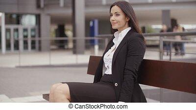 Optimistic business woman sitting outdoors - Optimistic...