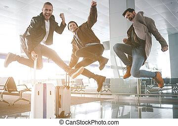 Optimistic friends having fun in airport