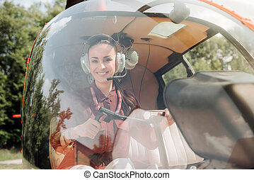 Optimistic happy woman training for piloting