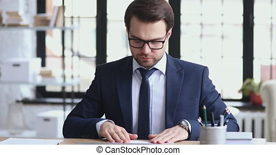 Optimistic male ceo wearing suit launching paper plane at ...