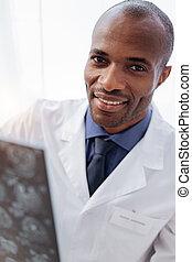 Optimistic male doctor perusing brain imaging