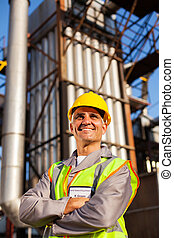 optimistic senior chemical industry worker in factory