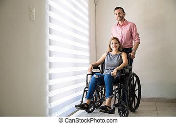 Optimistic woman on a wheelchair