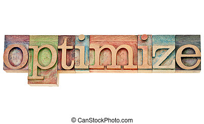 optimize - isolated word in vintage wood letterpress printing blocks stained by colorful inks