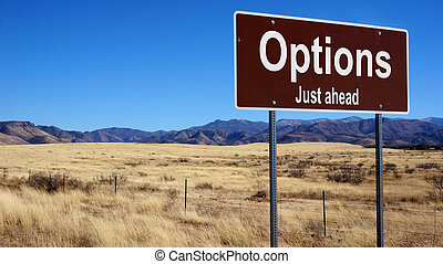 Options brown road sign - Options road sign with blue sky...