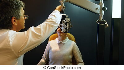 Optometrist examining patient eyes with messbrille 4k