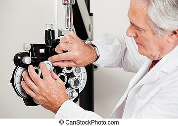 Optometrist Setting Phoropter For Eye Test - Optometrist...