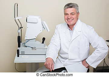 portrait of handsome elderly eye doctor