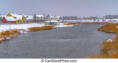 Oquirrh lake with view of snowy lakefront homes