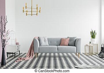 or, lampe, au-dessus, gris, sofa, à, rose, couverture, dans, spacieux, appartement, intérieur, à, plants., vrai, photo