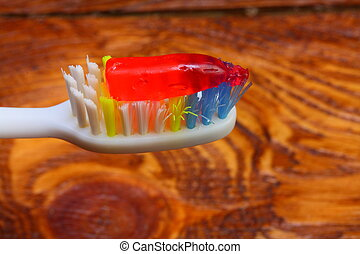 oral care - toothbrush with toothpaste applied thereto