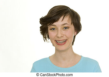 isolated teenager with beautiful teeth and brace