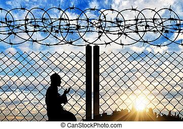 orando, cerca, silueta, refugiado