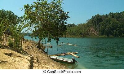Orang Asli Day Rafting, Temenngor Lake, Malaysia - Wide low-...