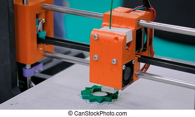 Orange 3D printer during work - Three dimensional printer...