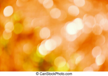 orange abstract background with blurred defocus bokeh light