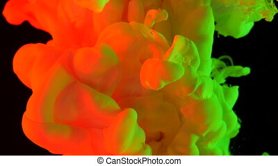 Orange and acid green ink in water shooting with high speed...