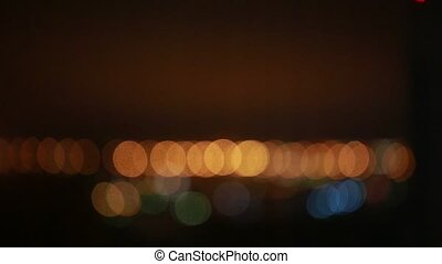 Orange and blue bokeh at night.